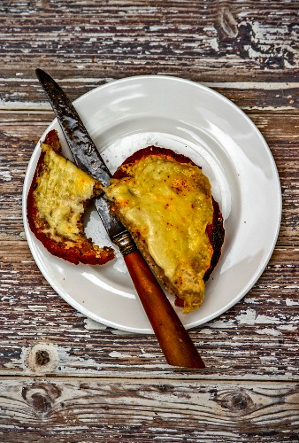 Cheese on toast with a bite out of it
