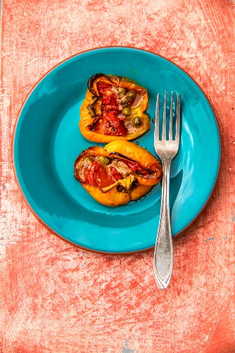 Yellow peppers stuffed with tomatoes, anchovies and capers (Piedmont, Italy)