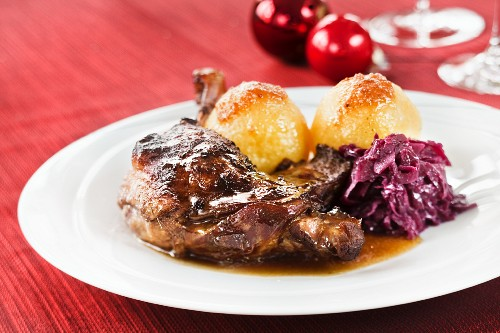 Goose leg with red cabbage and potato dumplings for Christmas