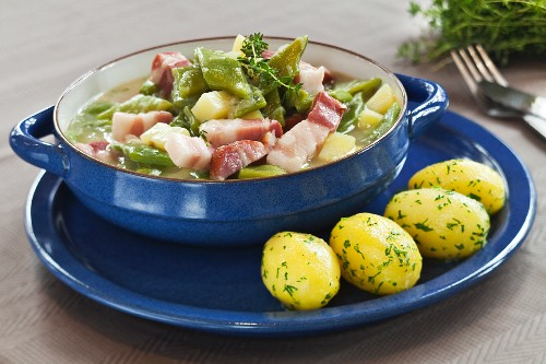 Bean stew with bacon and parsley potatoes