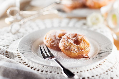 Apple doughnuts with icing sugar