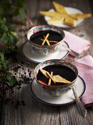Elderberry soup with poppy seed and polenta biscuits