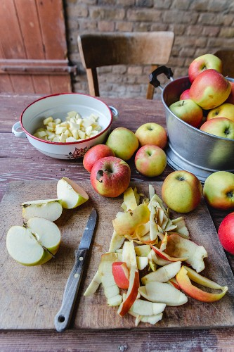 Fresh apples, whole and sliced, for an apple cake