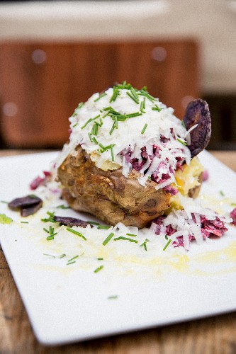 A jacket potato topped with beetroot salad