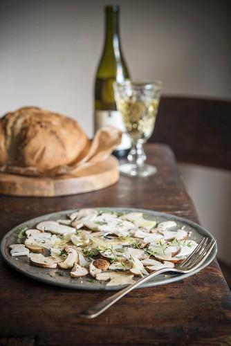 Porcini carpaccio with bread and wine