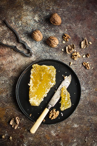 Sliced honeycomb and walnuts