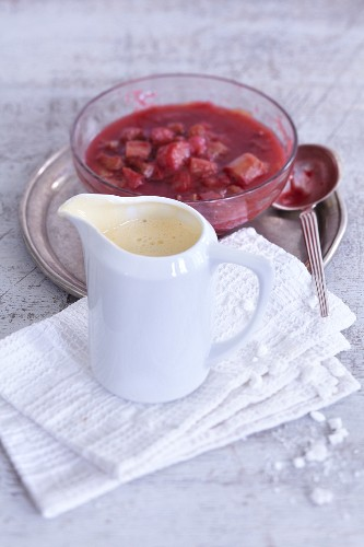 Strawberry and rhubarb compote with frothy woodruff sauce