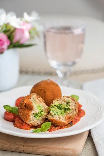Quinoa arancini with spicy tomatoes