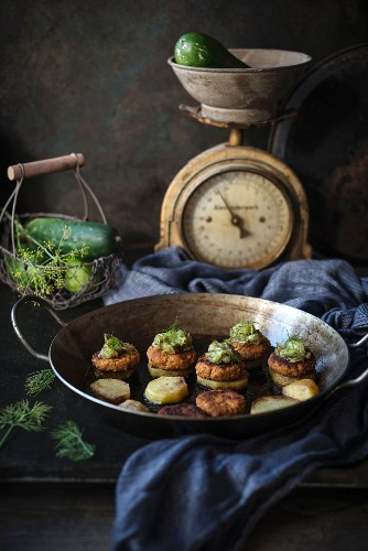 Fried potato slices with bean patties and gherkin relish (vegan)
