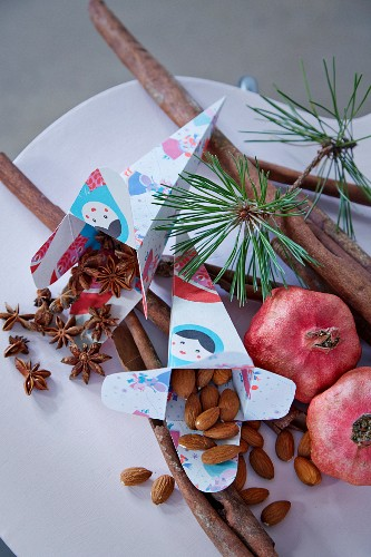 Almonds and star anise in paper gift bags