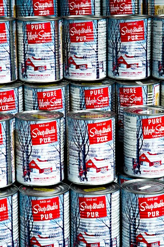 A stack of tinned maple syrup, Canada