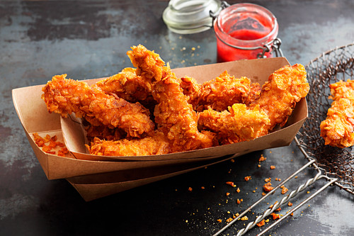 Deep-fried chicken strips with a cornflakes coking