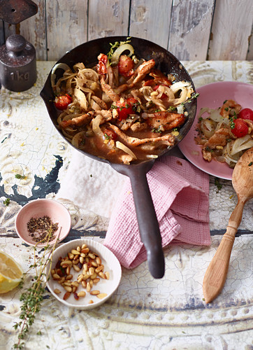 Turkey with tomatoes and pine nuts