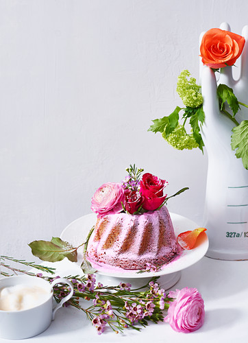 A pink Bundt cake decorated with flowers for Mother's Day