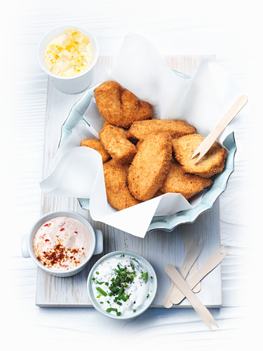 Chicken nuggets with various dips