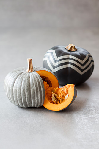 Pumpkins painted grey with white zigzags and stripes