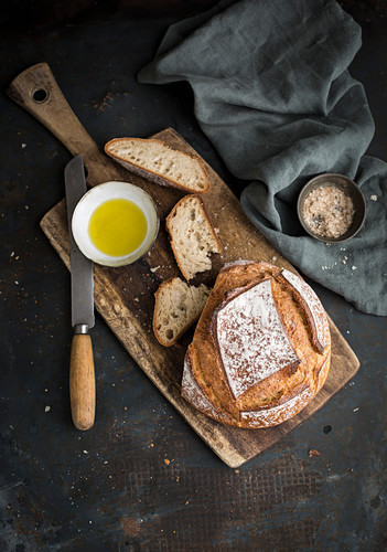 Bread on board with olive oil