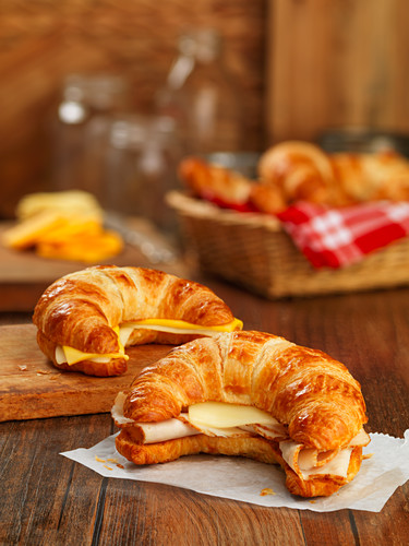Croissant sandwiches with sliced turkey breast and cheese