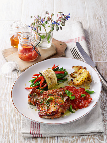 Chive escalopes with courgette rolls and tomato chutney