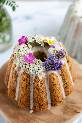 A zucchini and coconut cake decorated with flowers