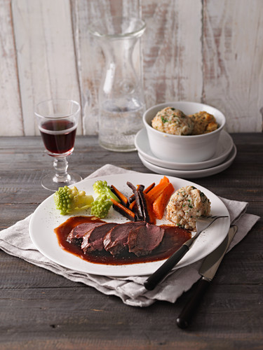 Saddle of venison with herb dumplings and vegetables