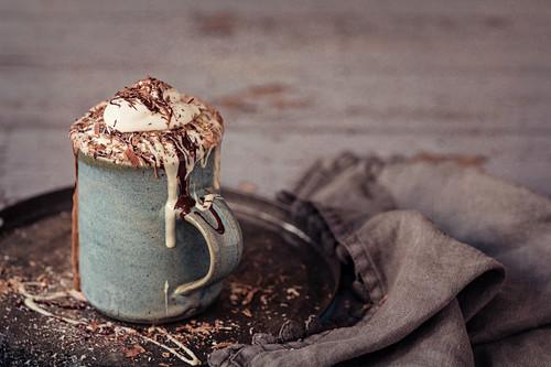 Luxury hot chocolate with dark, milk and white chocolate and fresh whipped cream