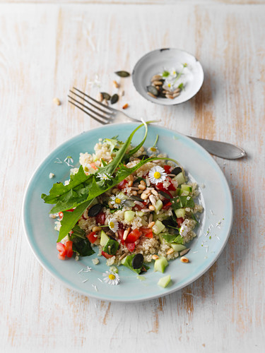Dandelion and quinoa salad with daisies