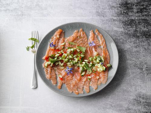Salmon trout carpaccio with a borage and cucumber vinaigrette