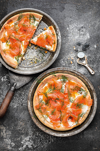 Smoked salmon pizza with sour cream and dill