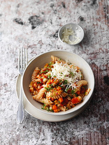 Chickpea fusilli with a vegetable ragout and Parmesan cheese