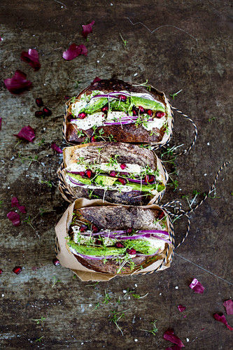 Avocado sandwiches with pomegranate seeds