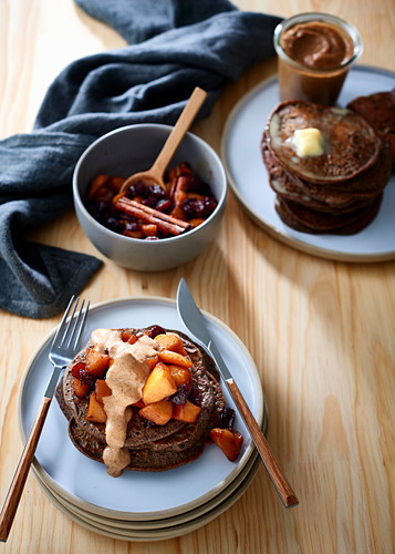 Rye and buckwheat pancakes with apple and cranberry compote, and date and almond butter