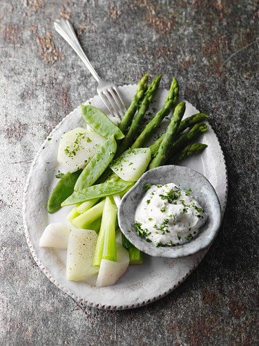 Steamed spring vegetables with a herb soya cream