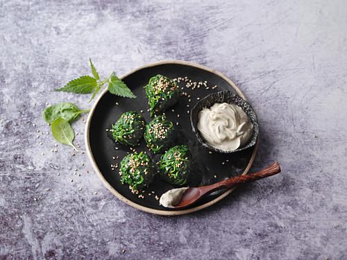 Vegan stinging nettle balls with a moringa and soya dip