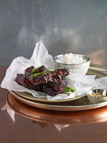 Sticky ribs with hoisin sauce served with rice