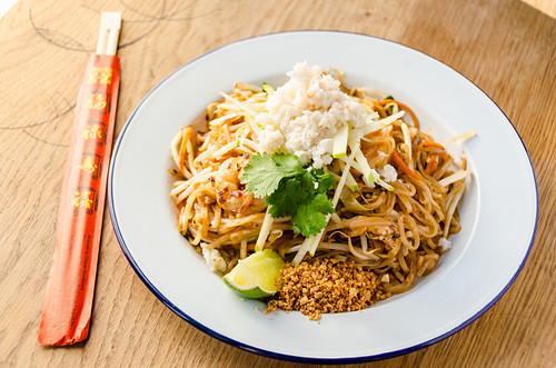 Pad thai stir fried noodles with prawns, chilli, beans, sprouts, spring onions, carrots, crab meat, shredded apple, lime and peanut