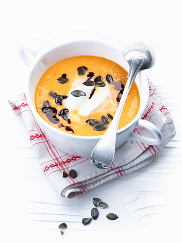Creamy pumpkin soup with pumpkin seeds and pumpkin seed oil