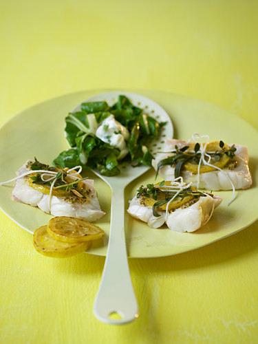 Lemon fish parcels with herbs and chard