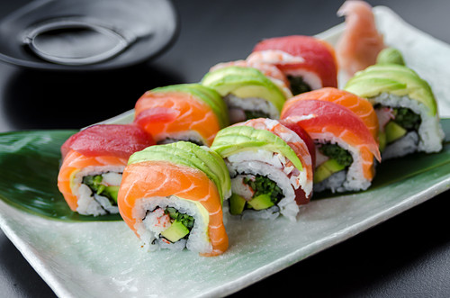 Japanese platter of rainbow rolls maki, inside out seaweed and rice roll