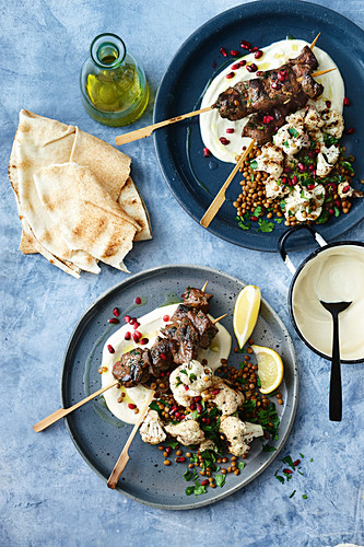 Lebanese skewers with charred cauliflower and lentil salad