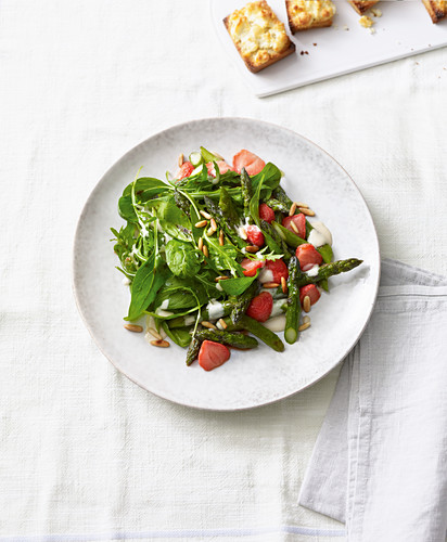 Asparagus and strawberry salad with tahini and lemon sauce