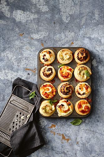 Scrolls with ham, cheese, pineapple scrolls; Sun-dried tomato, olive and cheese scrolls; Cheesy vegemite scrolls; Pesto and fetta scrolls