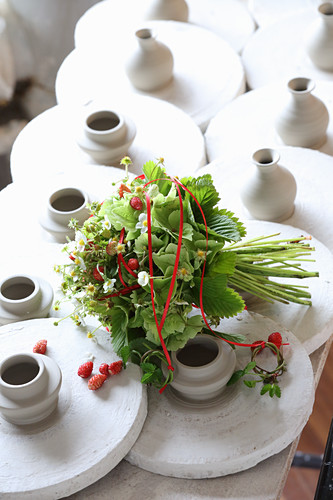 Bouquet of strawberry plants in potter's workshop