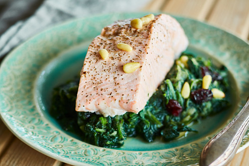 Steamed salmon with spinach and pine nuts