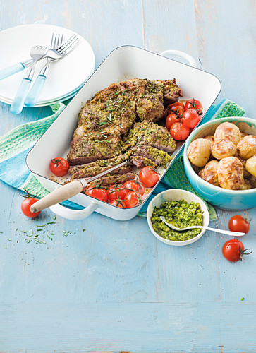 Butterflied lamb with macadamia and spinach pesto