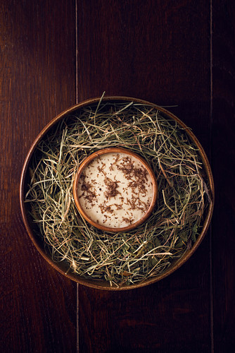 Mashed potatoes with truffle flakes served on a nest of hay