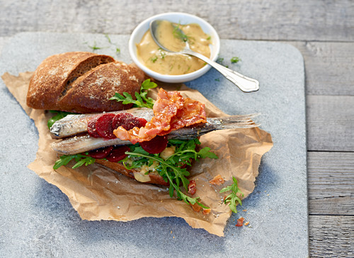 Herring rolls with beetroot, arugula and a dill and mustard dip