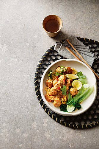 Meatballs on satay noodles