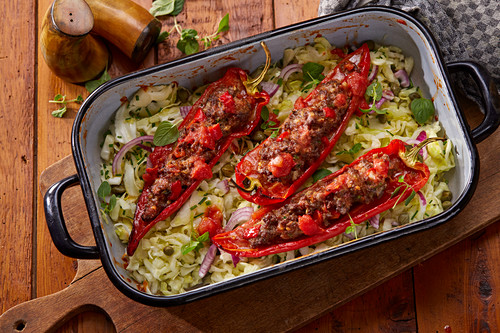 Pointed peppers filled with minced meat on a bed of cabbage