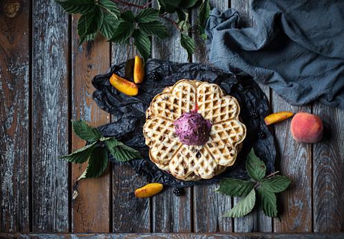 Vegan stracciatella waffle with blackberry and peach ice cream